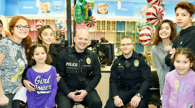 SUBMITTED PHOTO - Sheriff's deputies joined forces with 67 children last week during the annual Shop With a Sheriff program.
