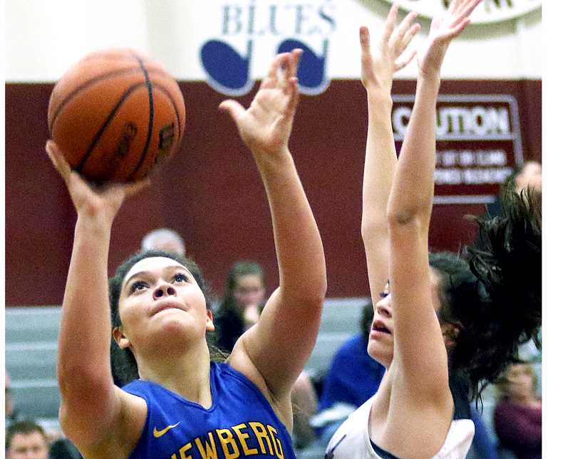 DAN BROOD - TIGARD/TUALATIN TIMES - Senior Andrea Ramos rises for a shot during Newberg's road contest at Sherwood Friday night. The Bowmen prevailed 46-38, but later forfeited their victory.