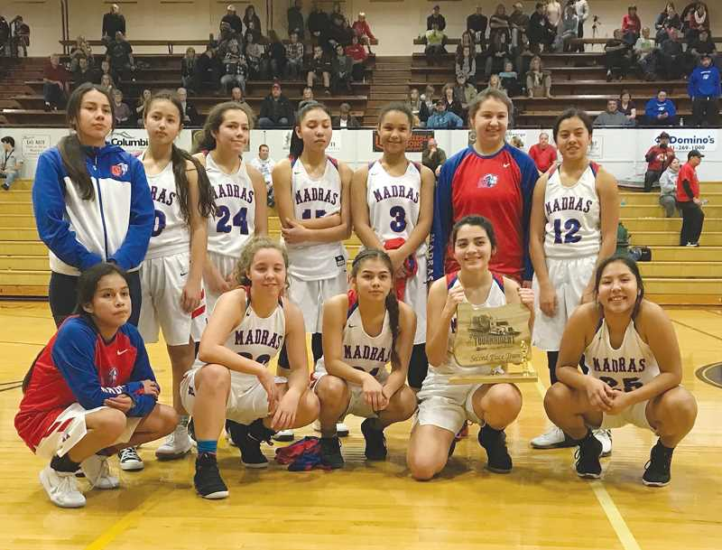PHOTO COURTESY OF JOHN GUNTHER/COOS BAY WORLD - The Madras girls basketball team accepts the  Marshfield Les Schwab Tournament second-place trophy in Coos Bay last Saturday. The Lady Buffs defeated North Bend and three-time reigning 4A state champion Sutherlin, before losing to No. 1-ranked Marshfield in the title game.