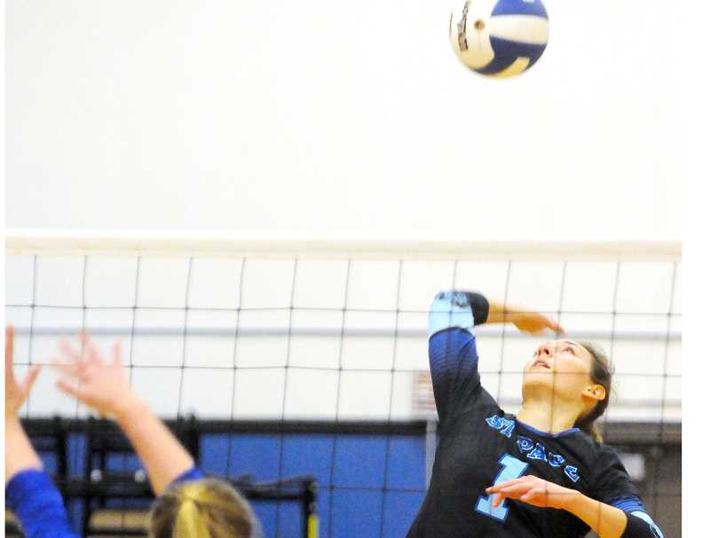 GRAPHIC FILE PHOTO - St. Paul's Logan Robinson lines up a hit this past season. The senior outside hitter was named first-team all-state after leading the Bucks to fourth place in 2A.