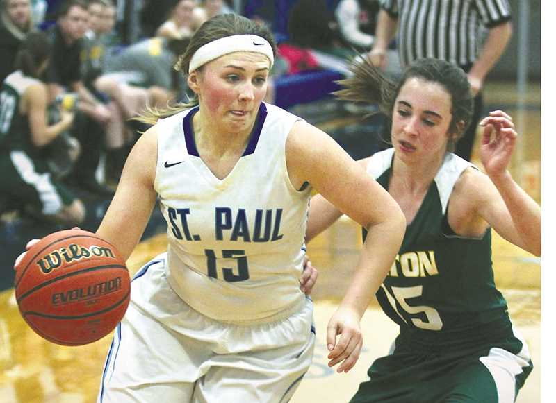 SETH GORDON - St. Paul sophomore Megan Tuck dribbles past a defender during the Buckaroos' 47-28 home victory over Colton Dec. 12.