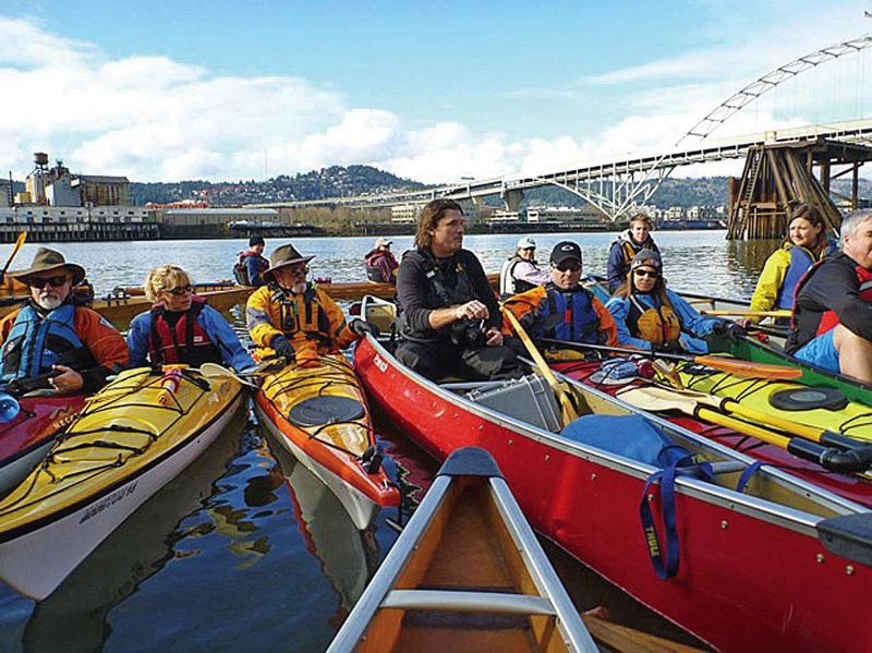 TRIBUNE FILE PHOTO: STEVE LAW - Travis Williams of Willamette Riverkeeper, in center, leads a kayak tour showing various polluted parts of the river that are part of the massive Superfund cleanup effort.