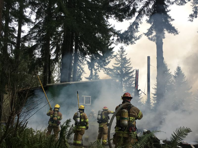PHOTO COURTESY OF COLUMBIA RIVER FIRE AND RESCUE - Columbia River Fire and Rescue crews responded to a mobile home fire on Hammon Road in Rainier Tuesday, Dec. 20. The home was deemed a total loss when crews arrived, and was threatening a nearby structure