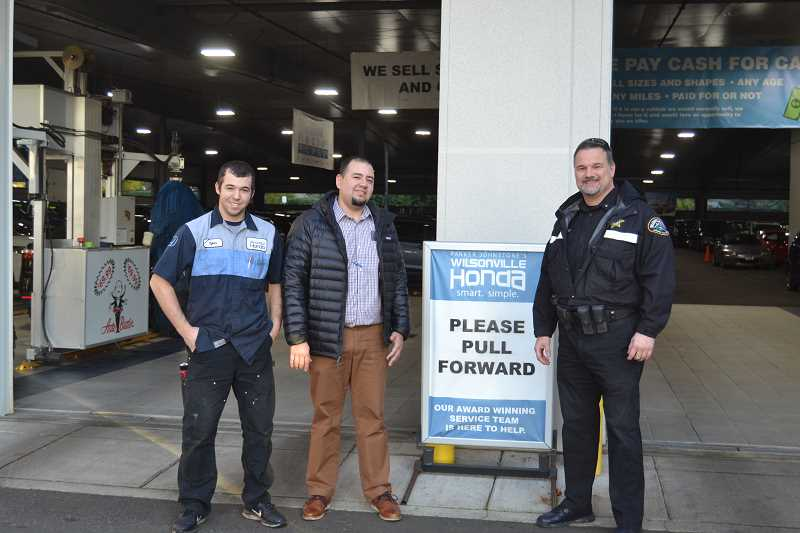 COURTESY PHOTO: CLACKAMAS COUNTY SHERIFF'S DEPARTMENT - Wilsonville Honda worker Tyler Tacla (left), Wilsonville Honda Service Manager Jose Moreno (middle) and Wilsonville Police Chief Rob Wurpes pose for a photo.