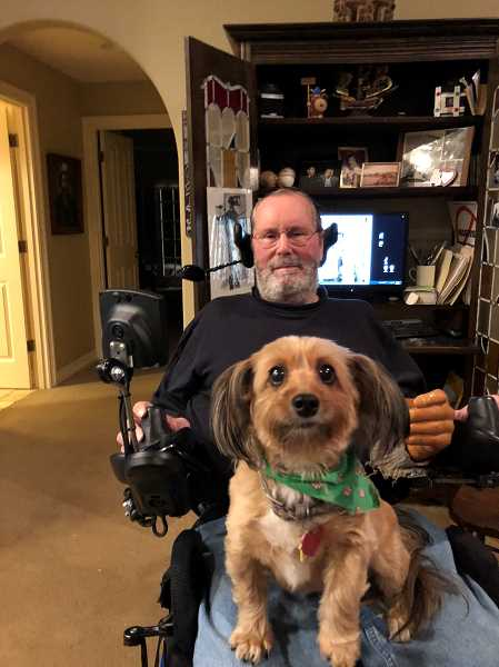 SUBMITTED PHOTO: LISA LIEBERMAN - Lucy sits on Craig Ackerson's lap in their Palisades home. The companion dog went missing for nearly a week before finally being found in the early morning of Dec. 12.