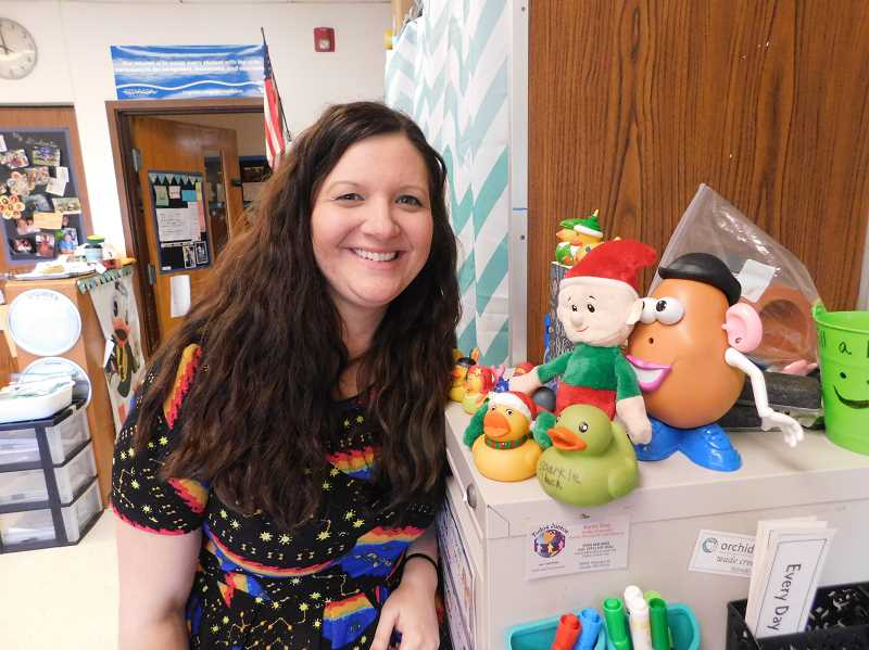 ESTACADA NEWS PHOTO: EMILY LINDSTRAND - Sara Schultz, a first-grade teacher at River Mill Elementary School, stands next to the Kindness Helper, an elf who has visited her classroom for the month of December to teach students about caring for others.
