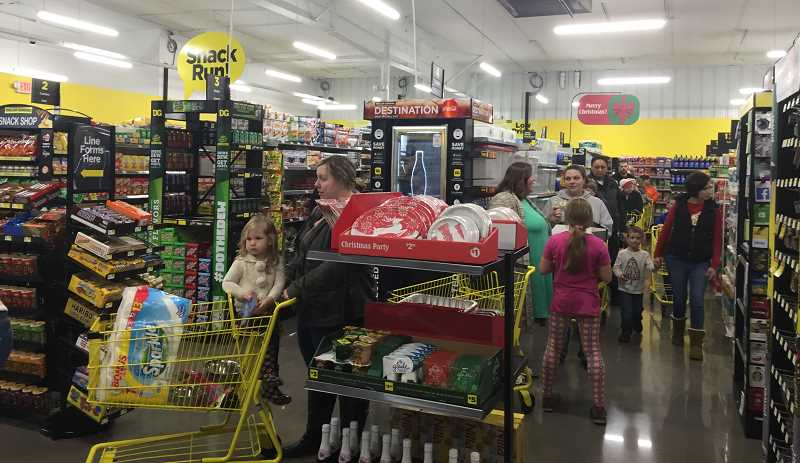 ESTACADA NEWS PHOTO: EMILY LINDSTRAND - Many Estacada residents stopped by the new Dollar General store when it opened for the first time on Monday, Dec. 18.