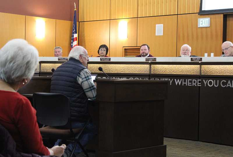 HOLLY M. GILL - The Madras City Council listens to testimony from Vic Delamarter on the city's plans to extend sewer in the Bel-Air and Herzberg Heights neighborhoods in northeast Madras.