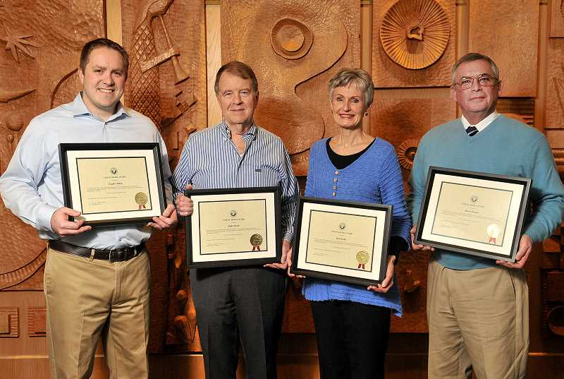 REVIEW PHOTO: VERN UYETAKE - Lake Oswego's Unsung Heroes for 2017 pose with their awards Tuesday at City Hall. From left: Taylor Finley, Duke Castle, Jan Castle and Mark Browne.