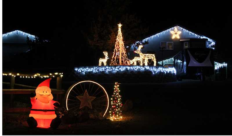 HOLLY M. GILL - A house and horse barn are lit up for Christmas on Southeast Crestview Lane, in the Canyon View neighborhood, which has many colorful light displays. But if viewing lights are part of your Christmas tradition, you can also find bright lights all around the county.