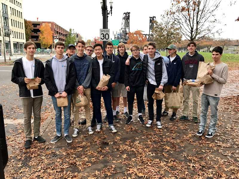 SUBMITTED PHOTO: NLYM LAKE OSWEGO CHAPTER - The 2018 class of the Lake Oswego chapter of the National League of Young Men pose in downtown Portland after helping feed the homeless at Potluck in the Park.