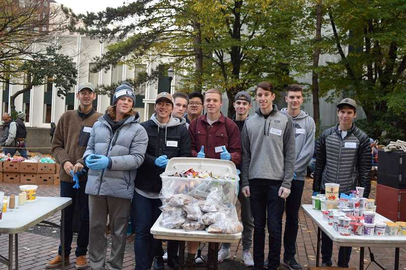 SUBMITTED PHOTO: NLYM LAKE OSWEGO CHAPTER - Members of the Lake Oswego chapter of the NLYM take part in Potluck in the Park, an event to feed the homeless in downtown Portland in November.