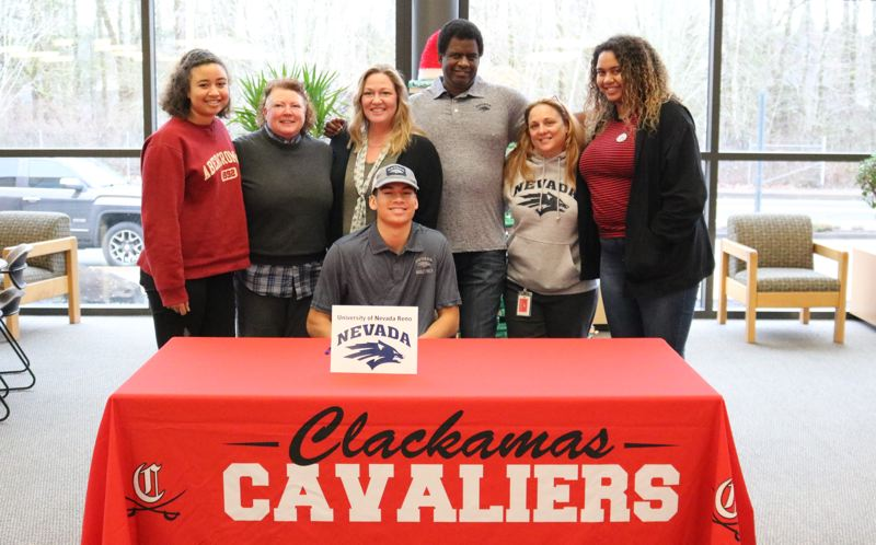 REVIEW/NEWS PHOTO: JIM BESEDA - Clackamas' Cole Turner (seated) had support from (standing, left to right) sister Brooklyn Turner, stepmother Sandy Tankersley, mother Holly Turner, father Kelly Turner, stepmother Christy Tuma and sister Jordyn Turner after signing a National Letter of Intent Wednesday morning to play football at the University of Nevada next fall.