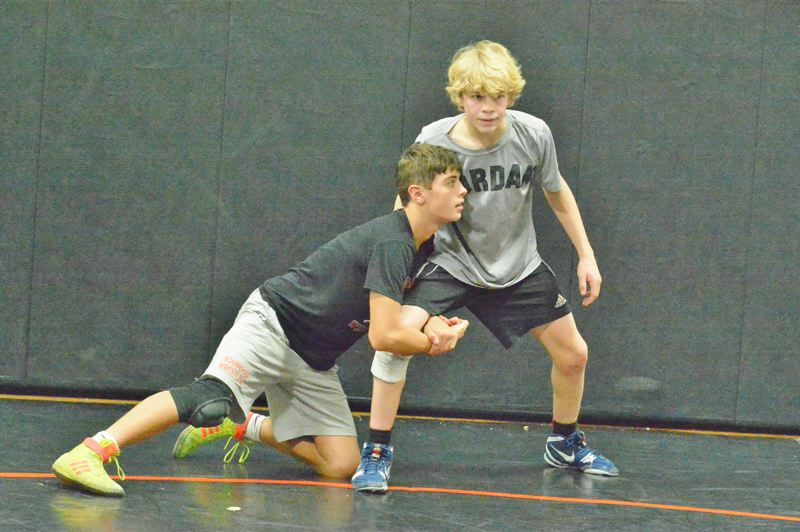 SPOTLIGHT PHOTO: JAKE MCNEAL - Indians sophomores Colton Frates, left, and AJ DeGrande, right, square off in practice Wednesday at Scappoose High School.