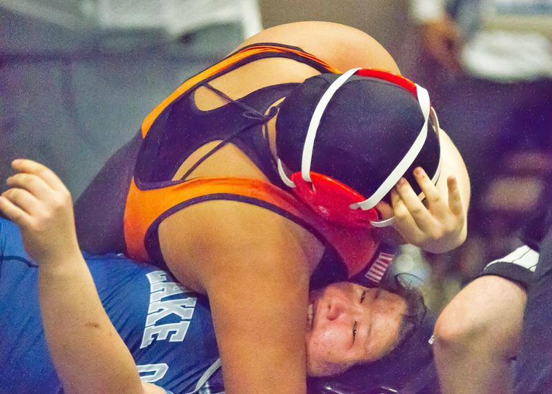 PHOTO CREDIT: LOREN WOHLGEMUTH - Indians freshman Isis Phillips goes for a pin.