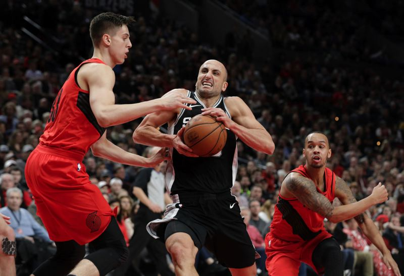 TRIBUNE PHOTO: JONATHAN HOUSE - Manu Ginobili of the San Antonio Spurs penetrates against Zach Collins (left), Shabazz Napier (right) and the Trail Blazers.