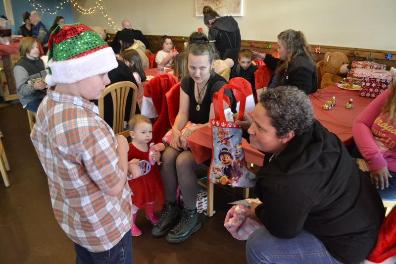 POST PHOTO: BRITTANY ALLEN - Jackson Clark, 10, and friends handed out stockings, presents and warm clothes and blankets to who attended his Christmas party for struggling families on Sunday, Dec. 17.