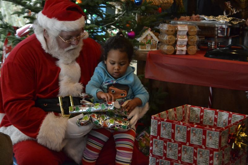 POST PHOTO: BRITTANY ALLEN - Little Alivia Trump was very excited to get her presents directly from Santa Claus this year.