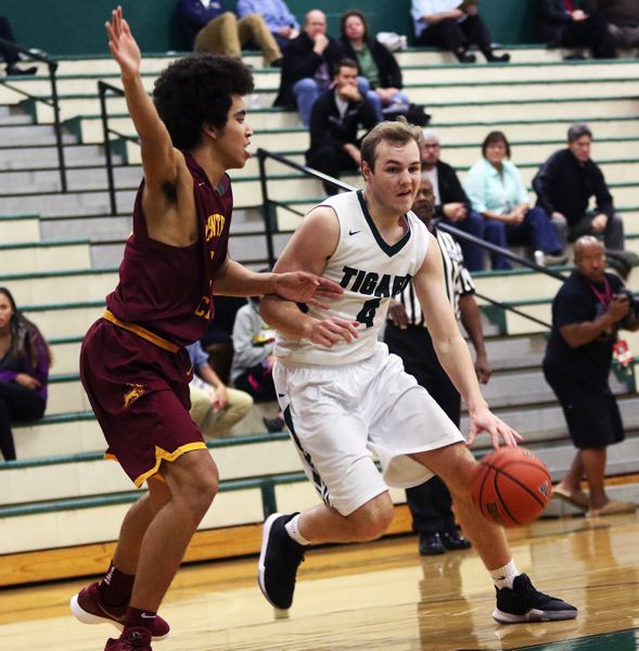 DAN BROOD - Tigard High School junior Stevie Schlabach (right), who earned first-team All-Three Rivers League honors last year, returns for the Tigers this season.
