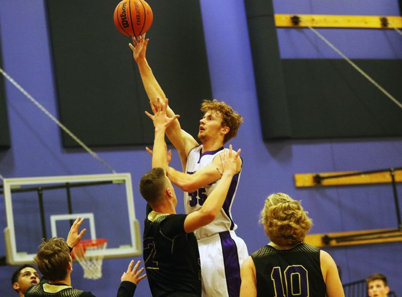 DAN BROOD - Horizon Christian senior Anthony Sprauer goes up high to take a shot during the Hawks' win over Portland Christian on Tuesday.