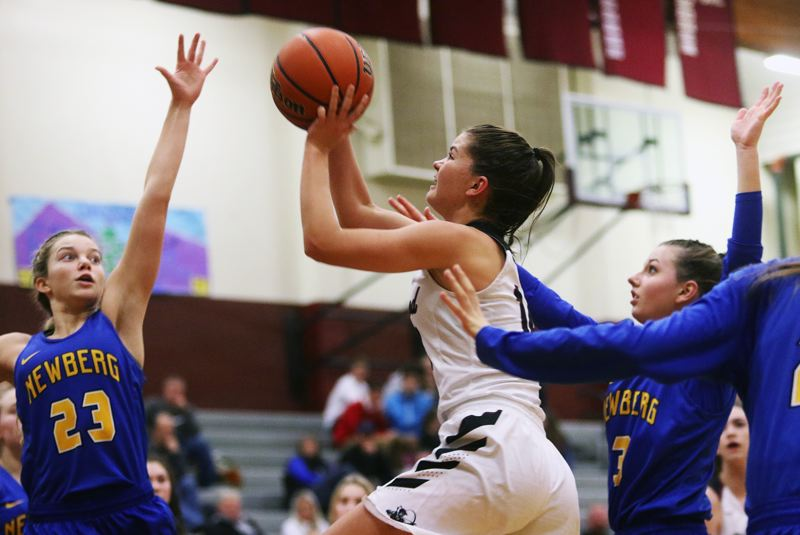 DAN BROOD - Sherwood junior Alex Verkamp takes a shot during the Lady Bowmen's game with Newberg.