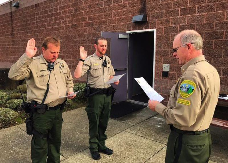 COLUMBIA COUNTY SHERIFF'S OFFICE PHOTO - Columbia County Sheriff Jeff Dickerson (right) swears in deputies Shaun McQuiddy (left) and Josh Lineberry (right) in 2016. Law enforcement agencies were re-evaluated for  public outreach and transparency. See the grades in the story below.