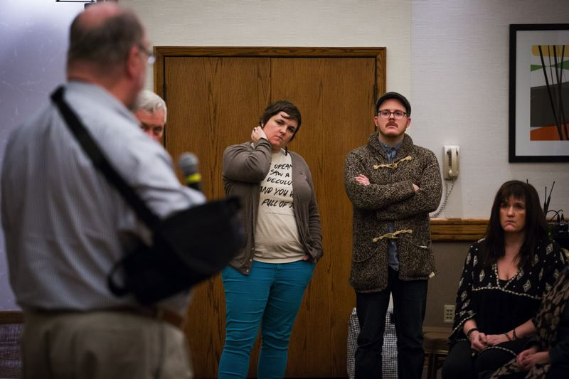 TRIBUNE PHOTO: ADAM WICKHAM - FamilyCare CEO Jeff Heatherington, in the sling , addresses providers who asked him to extend his Oregon Health Plan contract to prevent mental health episodes and possible suicides among patients. To do otherwise would be immoral and unethical, said counselor Kirk Shepard, in the glasses and hat.