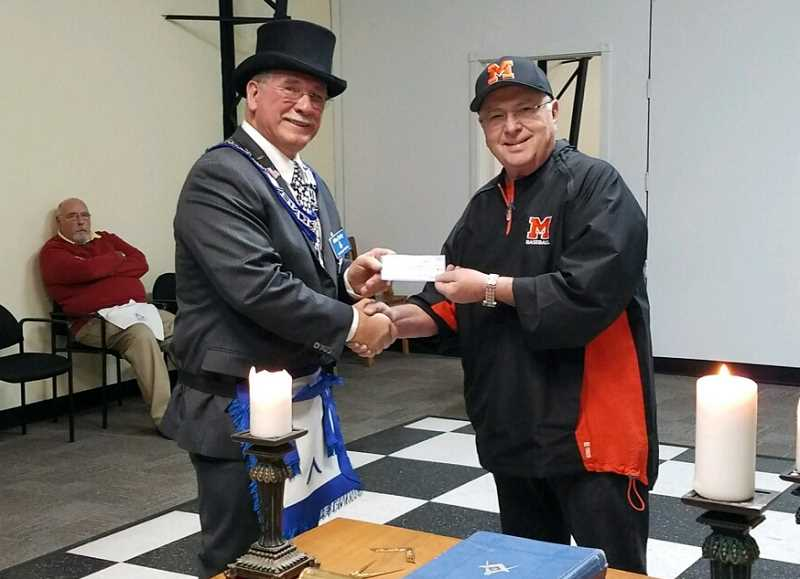 PHOTO COURTESY OF MIKE EARLY  - Molalla Masonic Lodge master Mike Early (left) presented Jim Dantona, the Molalla High School baseball team's head coach, with a $1,000 check on Wednesday evening.