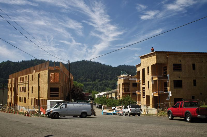 PAMPLIN MEDIA GROUP: FILE PHOTO - Many more apartment buildings like these in St. Johns will have to be built in the region to prevent the Urban Growth Boundary from being expanded, according to a report the Metro Council considered in 2014. Salem and Keizer look like good alternatives.