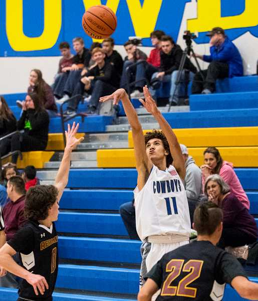 CENTRAL OREGONIAN FILE PHOTO - Thaiden Mullan hits a 3-pointer in a game earlier this year against Redmond. Mullan had three 3-pointers Tuesday against Woodcreek, California. Mullan added another three on Wednesday against Clackamas. Crook County lost both games.