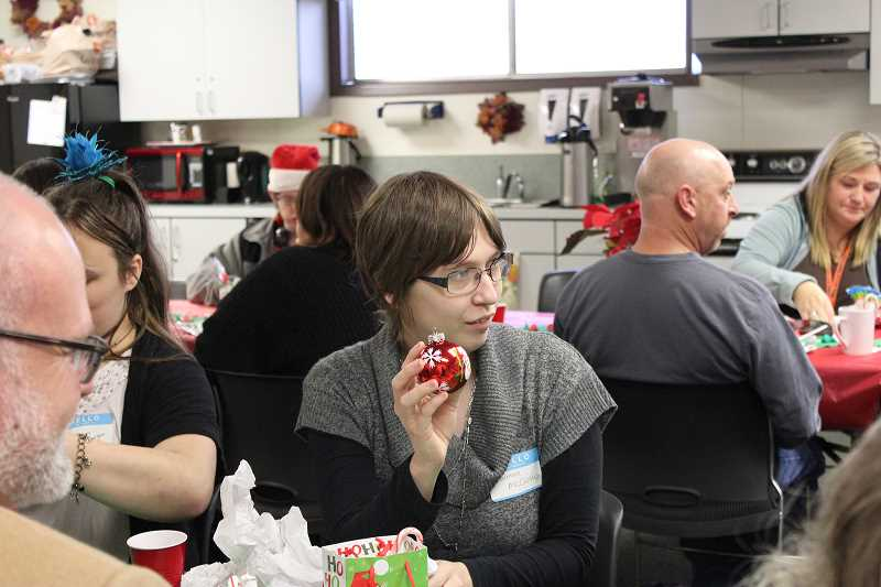 PIONEER PHOTO: KRISTEN WOHLERS - Students in Molalla River School District's Transition Program and district staff celebrated with an office holiday party on Dec. 15.