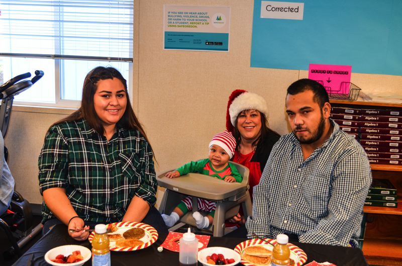 PHOTO COURTESY: GRACE SAAD - Enjoying this month's PACE holiday breakfast in Milwaukie are Alondra Guerrero-Duarte, 18, her baby, Tony, 1, Clackamas Sunrise Rotarian AnnaMarie Davault and Alondras fiance, Luis Acevedo.