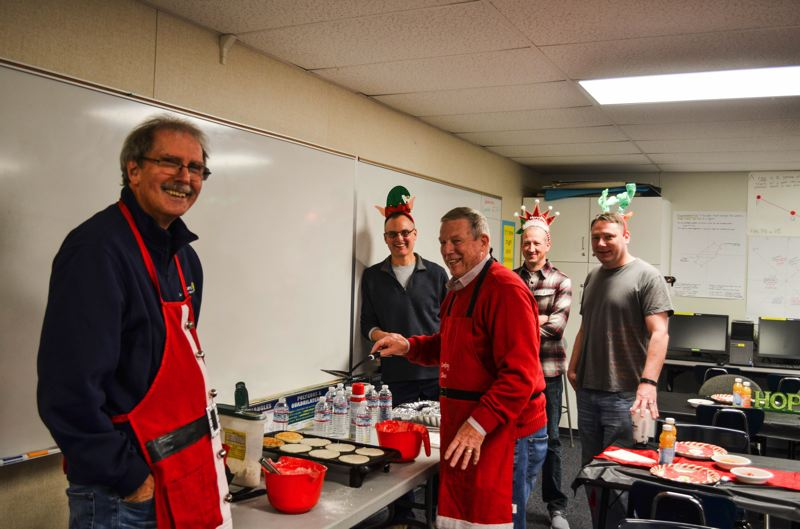 PHOTO COURTESY: GRACE SAAD - Clackamas Sunrise Rotarians preparing breakfast include (from left) Terry Mohr, Tim Isbell, David Lay, Darrel Hall and Eric Truitt.