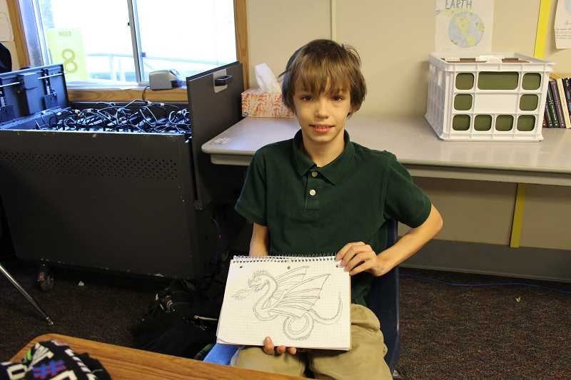 PIONEER PHOTO: KRISTEN WOHLERS - Alex Poschwatta shows off his artwork at Renaissance Public Academy Dec. 7.