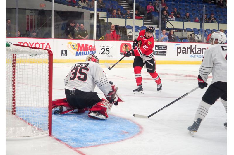 COURTESY: PORTLAND WINTERHAWKS - Kieffer Bellows fires a shot on goal for the Portland Winterhawks. Bellows has been training with the U.S. World Junors team, hoping it can repeat as tournament champion.