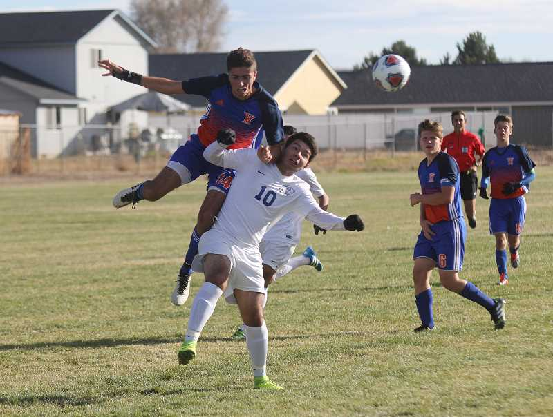 WILL DENNER/MADRAS PIONEER - Madras junior Andres Acuna (10) fends off a Hidden Valley player in a first-round playoff game Nov. 1, which the Buffs won 3-0.