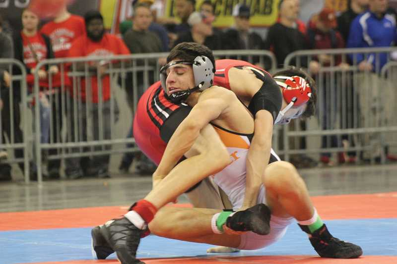 WILL DENNER/MADRAS PIONEER - At the 2A/1A State Wrestling Tournament last February, Jorge Olivera was one of four individual state champions for Culver.