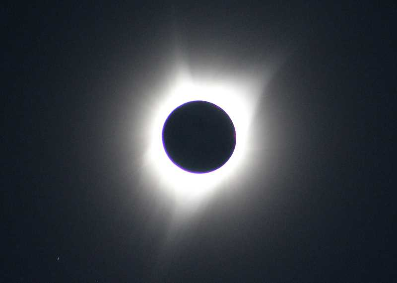 HOLLY M. GILL - In Madras, the total solar eclipse began at 10:19 a.m. on Aug. 21, and lasted for 2 minutes and 4 seconds.
