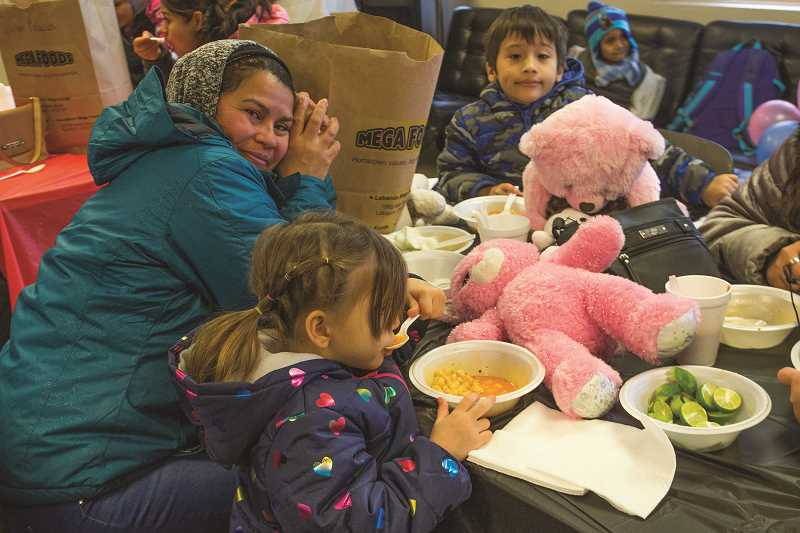INDEPENDENT PHOTO: JULIA COMNES - More than 300 toys were distributed to Woodburn families.