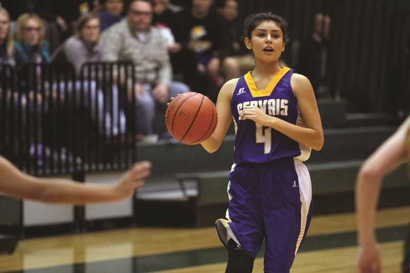 PHIL HAWKINS - Senior Karina Ramos led the Cougars with 10 points in the 43-36 win over Regis Thursday night.