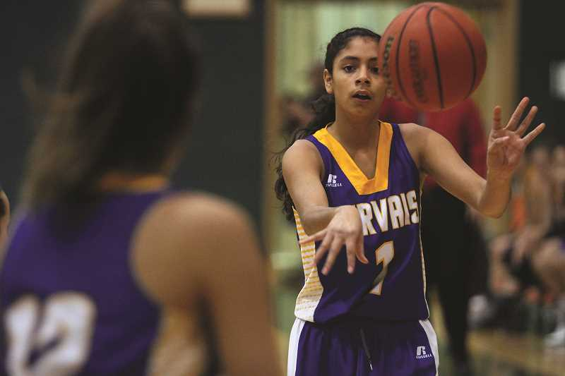 PHIL HAWKINS - Celi Vasquez looks for an opening to pass the ball during the Cougars' 43-36 victory over the Regis Rams Thursday night.