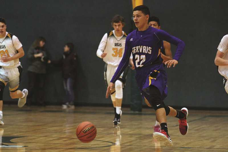PHIL HAWKINS - Gervais junior Pedro Villegas connected on three of the Cougars' 10 3-pointers in the team's 71-55 loss to the Regis Rams on Thursday.