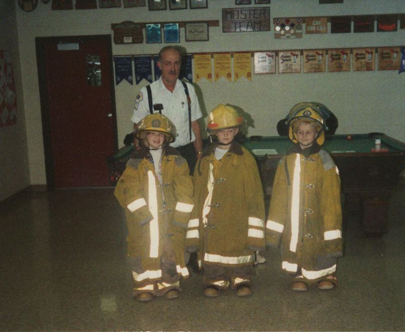 COURTESY - Former Gaston Fire Chief Ron Hoodenpyl teaches schoolchildren to stop, drop and roll in an undated photo.
