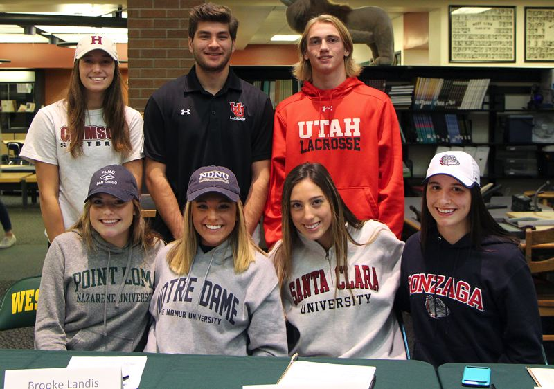 SUBMITTED PHOTO - Seven of West Linn's best athletes signed national letters of intent in November, including (front row, left to right) Kennedi Byram, Brooke Landis, Lexie Pritchard and Grace Nickas, and (back row) Kaitlin Lampson, A.J. Krakauer and Reed Rissberger.