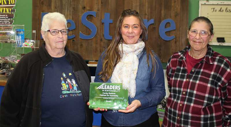 Enjoying the moment are (from left) Joanne Barr, volunteer; Connie Farrier, district manager; and Mary LeFebvre, volunteer.