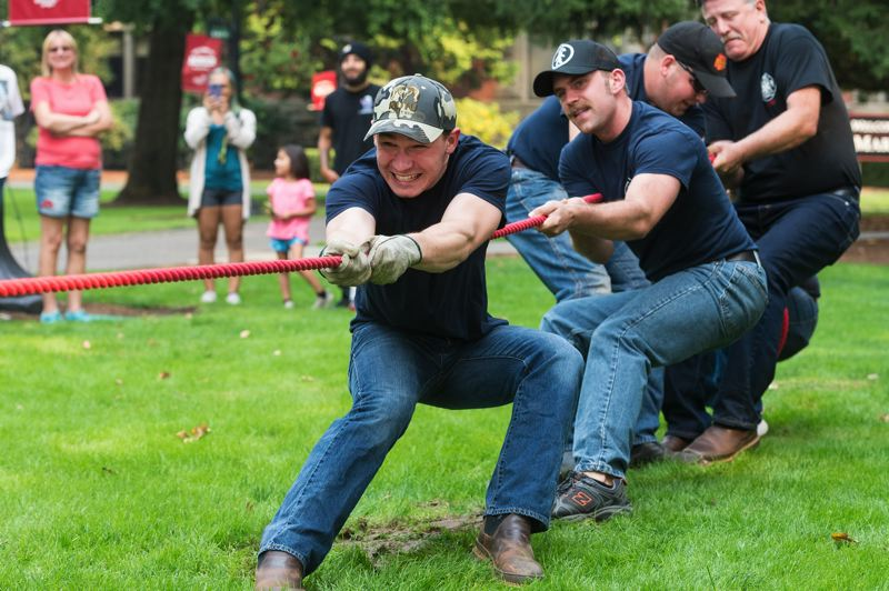 NEWS-TIMES FILE PHOTO: CHRISTOPHER OERTELL - Banks and Forest Grove firefighters battle each other in a game of tug-of-war during the Corn Roast on the campus of Pacific University in September.