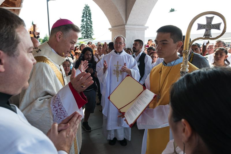 NEWS-TIMES FILE PHOTO: CHRISTOPHER OERTELL - Archbishop Alexander K. Sample greets parishoners at the Rite of Dedication at St. Alexander Church in Cornelius in July.