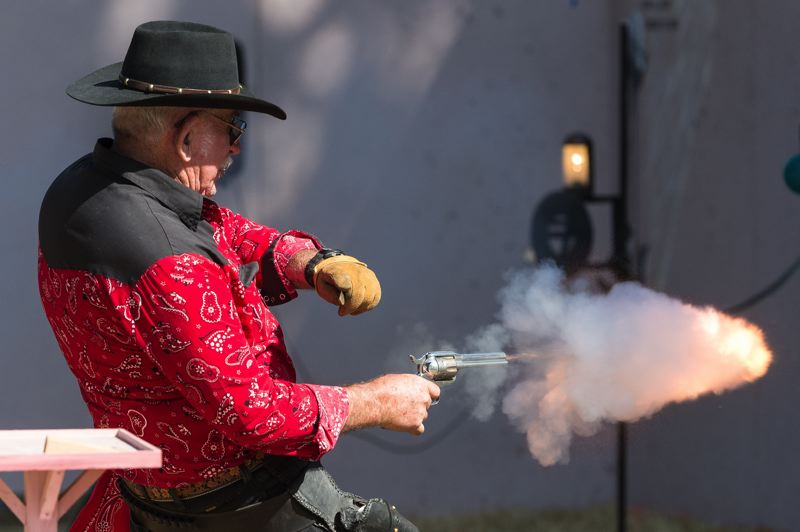 NEWS-TIMES FILE PHOTO: CHRISTOPHER OERTELL - Howard Baker of Forest Grove fires his gun during the Oregon 6 Gun Fast Draw World Championships at the Banks BBQ in August.