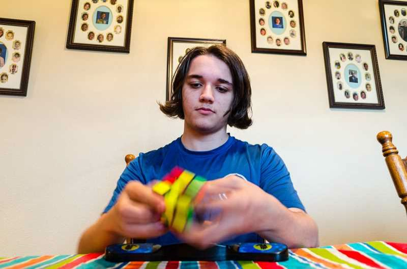 NEWS-TIMES FILE PHOTO: CHASE ALLGOOD - Blink and you'll miss Ben Gottschalk of Gaston solving a Rubik's Cube with lightning speed.