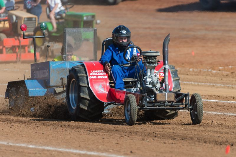 NEWS-TIMES FILE PHOTO: CHRISTOPHER OERTELL - Tyler Clough, 10, from Hillsboro, drives his InchPincher during the Tractor and Truck Pull competition in Banks.